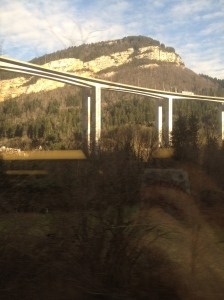 Zooming past the Jura and a mountain highway.