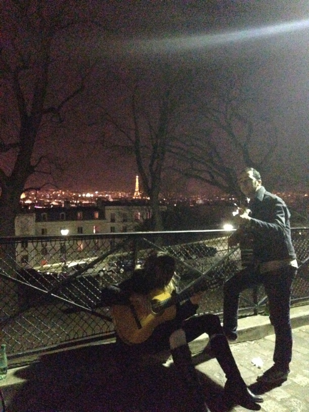 Me, playing guitar with my new friend, Eiffel Tower in the distance.